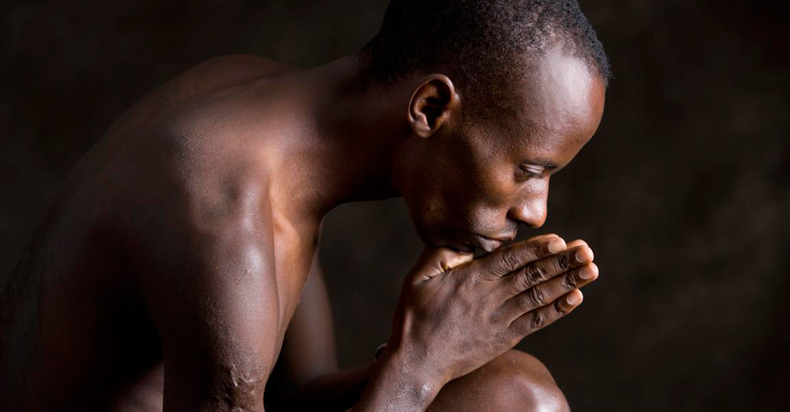 Gilbert Tuhabonye in prayer
